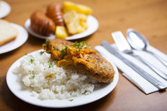 Boiled rice with meat cutlet. And carrots Royalty Free Stock Photography