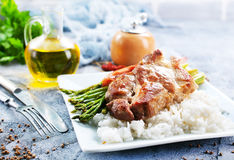 Rice with asparagus and meat Royalty Free Stock Images
