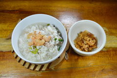 Boiled rice minced pork and dried shrimp with fried garlic on bowl Stock Photo