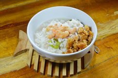 Boiled rice with minced pork and dried shrimp topping fried garlic on bowl Royalty Free Stock Images