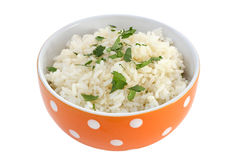 Boiled rice in orange bowl Stock Images