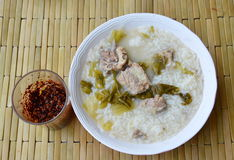 Boiled rice in pickled Chinese cabbage and pork bone soup with fried chili paste Royalty Free Stock Image