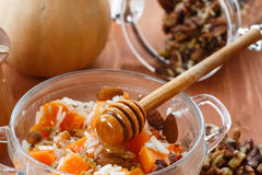 Boiled rice with pumpkin and nuts Stock Photo