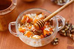 Boiled rice with pumpkin and nuts Royalty Free Stock Image