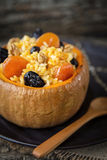 Boiled rice in a pumpkin. With prunes dried apricots with honey almonds Stock Photos