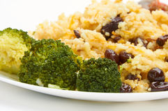 Boiled rice with raisins on white plate Stock Photo