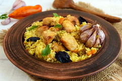Boiled rice with roasted chicken, carrots, spices (traditional Asian dish - pilaf). Stock Photo