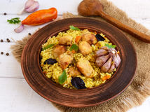 Boiled rice with roasted chicken, carrots, spices (traditional Asian dish - pilaf). Royalty Free Stock Image