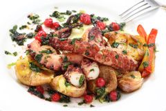 Boiled and roasted octopus-portuguese traditional food. Mediterranean diet royalty free stock photo