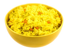 Boiled saffron rice with vegetables in yellow bowl. Isolated on white background Stock Images