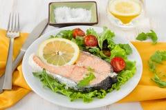 Boiled salmon with lemon Royalty Free Stock Photos