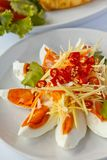 Boiled salted eggs with spicy toppings Stock Image