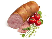 Boiled sausage decorated with tomatoes, onion... Boiled sausage decorated with tomatoes, onion and green pea over white background Royalty Free Stock Photo
