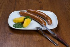 Boiled sausages on a plate stock image