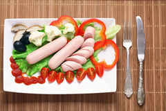 Boiled sausages serving with Stock Photos