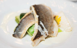 Boiled seabass with steamed vegetables Royalty Free Stock Image