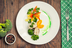 Boiled seabass with steamed vegetables - totally healthy meal. Top view. Close-up Stock Photos