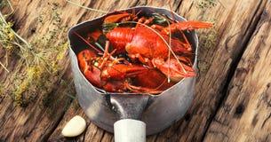 Boiled shellfish in pan Stock Image