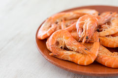 Boiled shrimp with lemon arranged on a a plate - selective focus Stock Photography