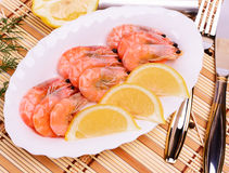 Boiled shrimp on an oval platter. Royalty Free Stock Images