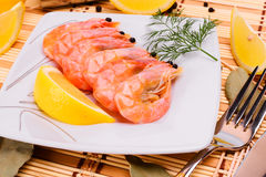 Boiled shrimp on an oval platter. Royalty Free Stock Photo