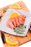 Boiled shrimp on a square plate. Stock Photo