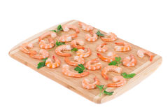 Boiled shrimps on cutting board. Stock Photography