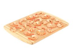 Boiled shrimps on cutting board. Stock Photo
