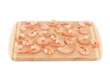 Boiled shrimps on cutting board. Royalty Free Stock Photos