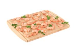 Boiled shrimps on cutting board. Stock Photos