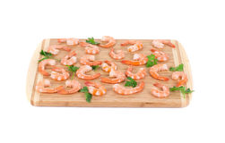 Boiled shrimps on cutting board. Royalty Free Stock Photography