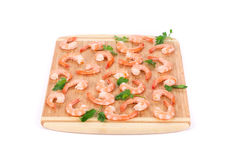 Boiled shrimps on cutting board Stock Photos