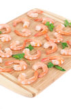 Boiled shrimps on cutting board. Stock Images