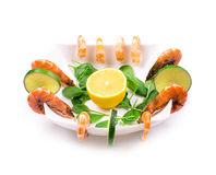 Boiled shrimps and fresh spinach. Stock Images