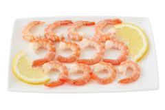 Boiled shrimps with lemon Royalty Free Stock Photos