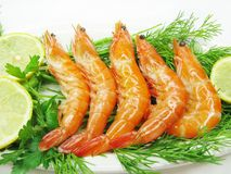 Boiled shrimps with lemon slices and parsley Royalty Free Stock Image