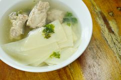 Boiled slice bamboo shoot with pork bone soup on bowl. Boiled slice bamboo shoot with pork bone soup on white bowl royalty free stock photo