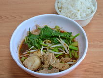 Boiled slice pork in brown soup eat with rice Stock Photos