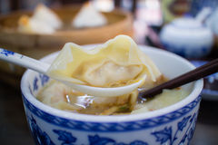 Boiled small dumplings with pork in the Chinese restaurant Stock Photos