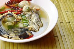 Boiled smoked dry snake head fish in spicy and sour soup on bowl. Boiled smoked dry snake head fish in spicy and sour soup on the bowl Stock Photography