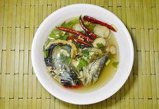 Boiled smoked dry snake head fish in spicy and sour soup on bowl. Boiled smoked dry snake head fish in spicy and sour soup on the bowl Stock Photo