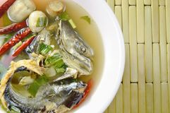 Boiled smoked dry snake head fish in spicy and sour soup on bowl. Boiled smoked dry snake head fish in spicy and sour soup on the bowl Royalty Free Stock Photo