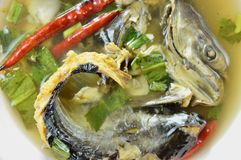 Boiled smoked dry snake head fish in spicy and sour soup on bowl. Boiled smoked dry snake head fish in spicy and sour soup on the bowl Royalty Free Stock Images