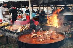 Boiled smoked pork shanks and ham. Festival of street food and meat. stock image