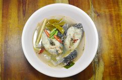 Boiled snake head fish in hot and spicy tom yum soup on bowl. Boiled snake head fish in hot and spicy tom yum soup on the bowl Royalty Free Stock Photography