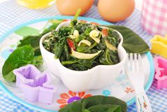 Boiled spinach with egg for baby Royalty Free Stock Photography