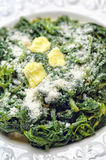 Boiled spinach on white plate with butter Stock Images