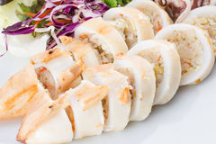 Boiled squid served in white dish Stock Photo
