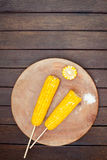 Boiled sweet corn cobs with salt on  wooden background Stock Photo