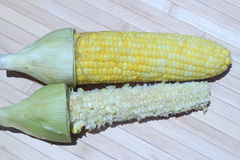 Boiled sweet corn eaten also placed on brown background Stock Photo